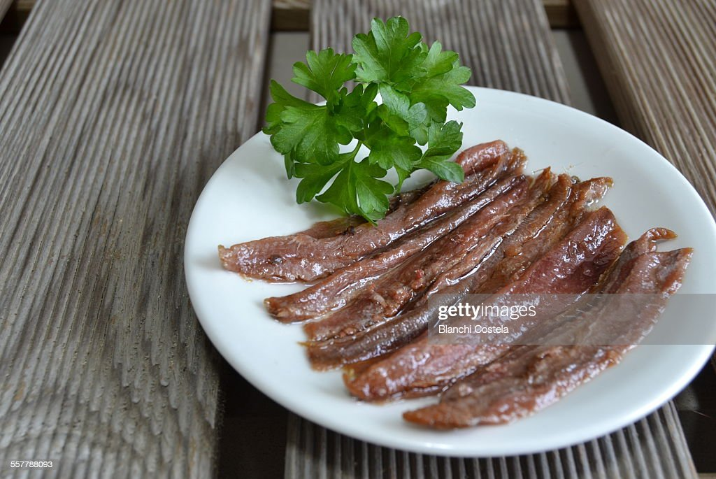 Anchovy fillets on a white plate : Foto stock