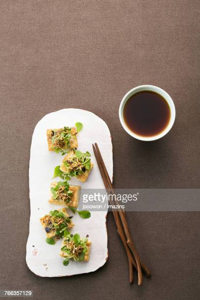 anchovy tofu canape - soy sauce stock photos and pictures