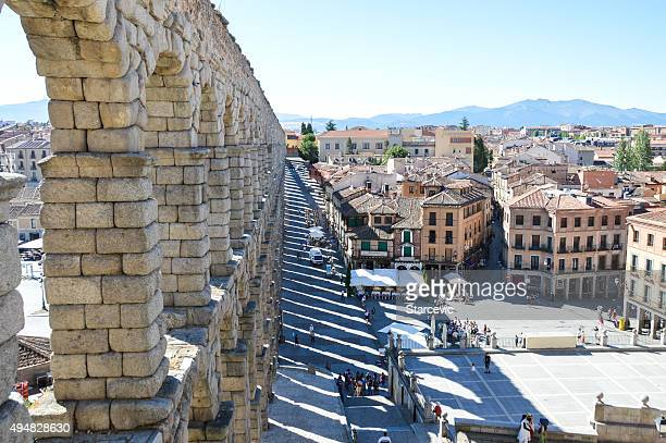 Ancient aquaduct and town plaza in Segovia, Spain