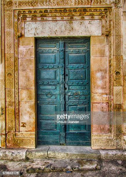 ancient arabic style door, sfax, tunisia - tunisia stock pictures, royalty-free photos & images