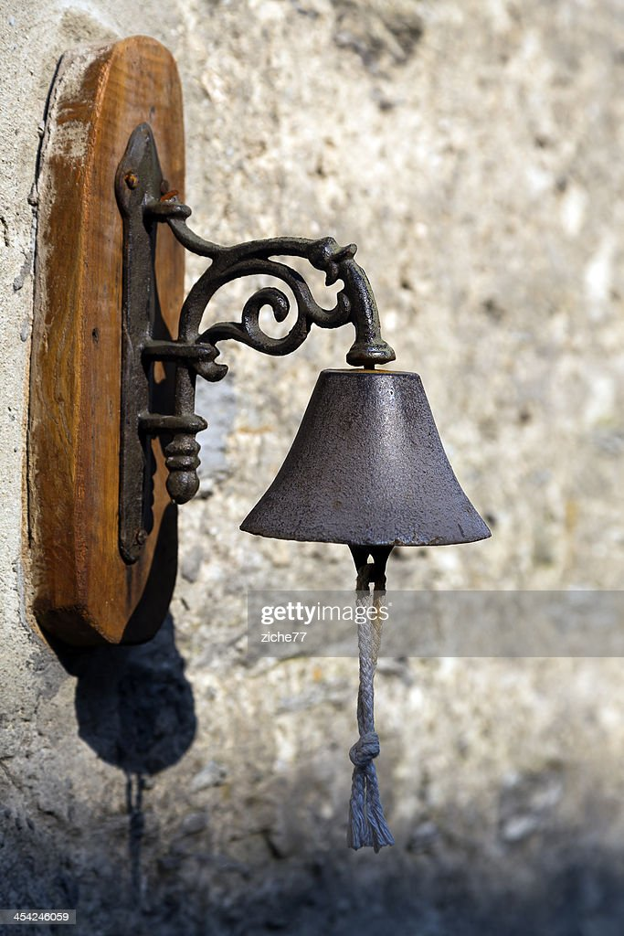 Ancient bell on a wall : Stock Photo