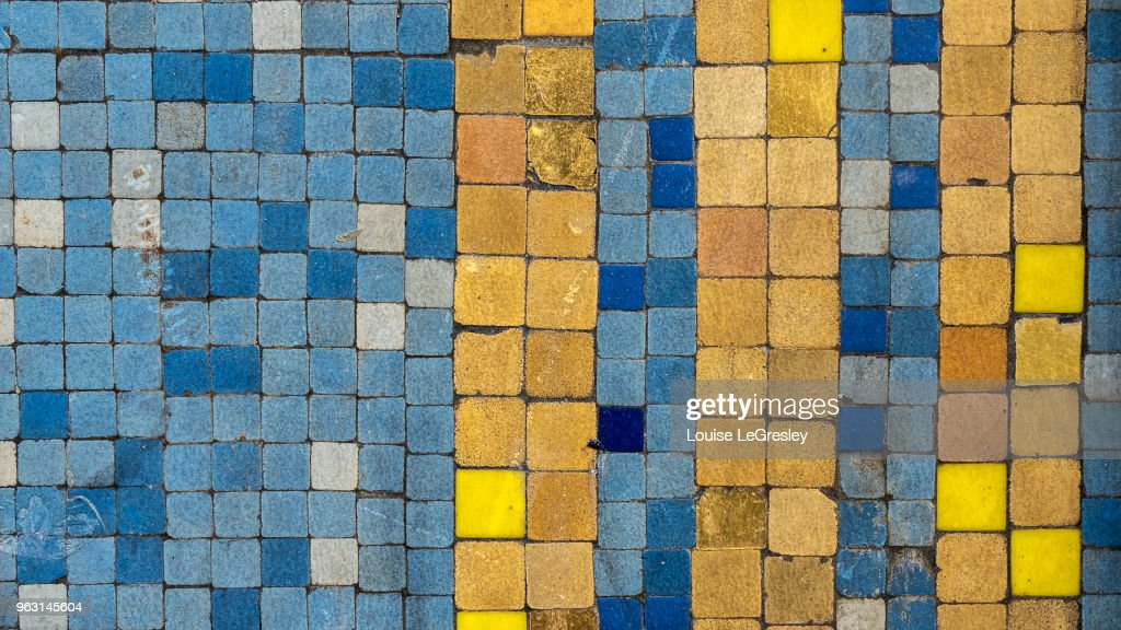 Ancient blue and yellow mosaic tiles : Stock Photo