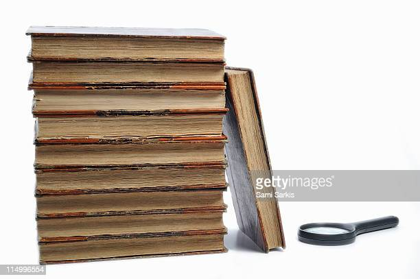 Ancient books and magnifying glass