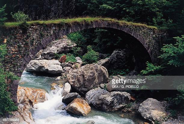 Ancient bridge over the river Brembo near Isola Fondra Lombardy Italy