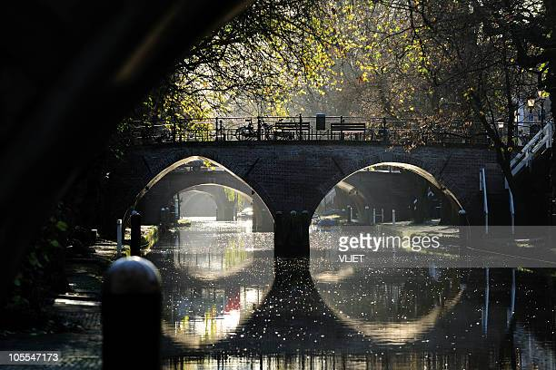 ancient bridges over canal oudegracht in utrecht the netherlands - utrecht stockfoto's en -beelden
