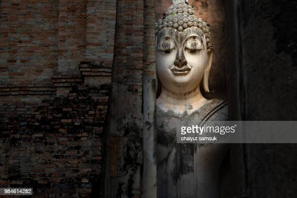 ancient buddha statue. sukhothai historical park - yangon stock pictures, royalty-free photos & images