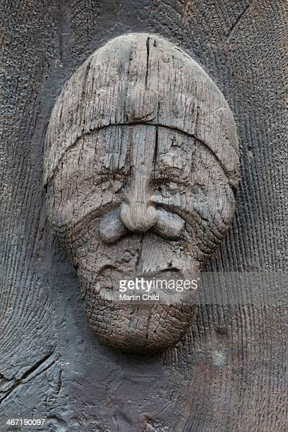 ancient carving of a man's face