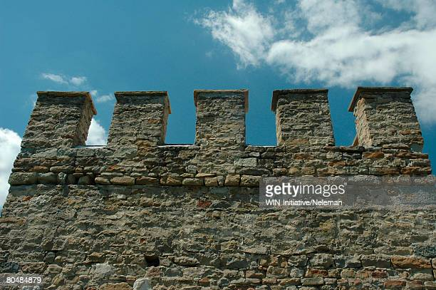 ancient castle wall with dents - fortified wall stock pictures, royalty-free photos & images