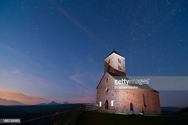 Ancient church in the mountains at night