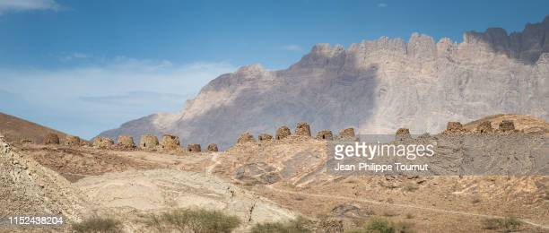 ancient civilization remains - the beehive tombs of al ayn on a ridge of oman rocky mountains, sultanate of oman, arabian peninsula - tomb stock pictures, royalty-free photos & images