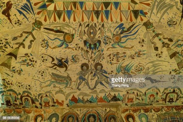 Ancient colorful murals on the cave wall telling about stories of Buddhism are mostly artworks of Tang Dynasty The Mogao Caves also known as the...