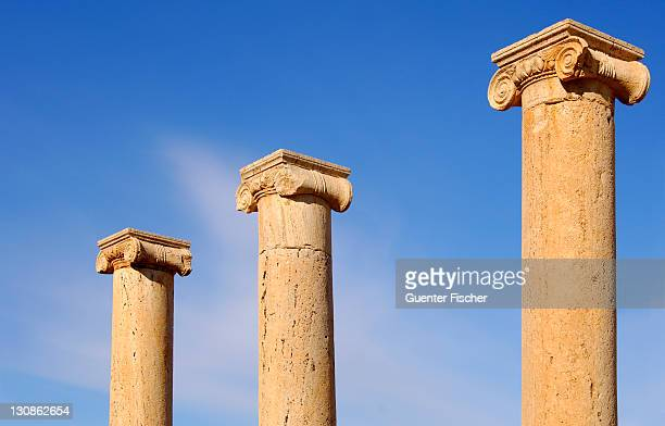 Ancient columns iwith ionic capital, ruins of the Roman City Leptis Magna, Libya