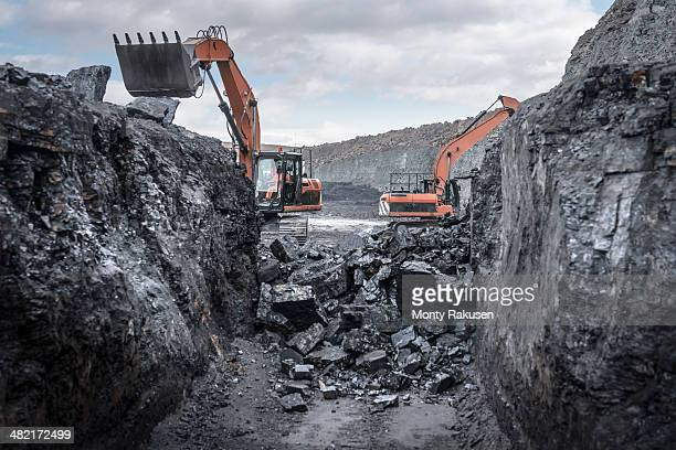 ancient deep coal workings in surface coal mine - coal mining stock photos and pictures