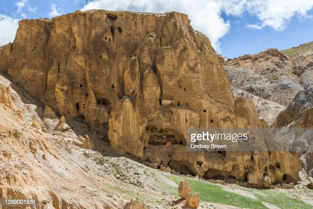 ancient deserted cave complex including housing and temples on the outskirts of lo manthang. - lo manthang stock pictures, royalty-free photos & images