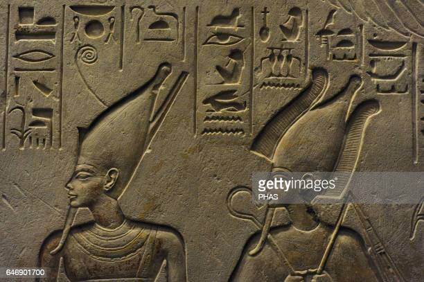Ancient Egypt Stele of Haremheb head of the Army to reign Tutankhamen The deceased adoring three gods Detail Atum and Osiris Limestone 14th13th...