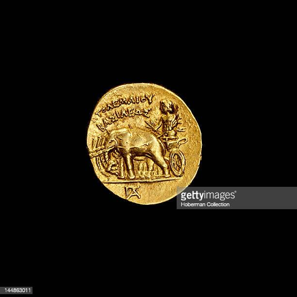Ancient Egyptian coin depicting Alexander the Great driving a quadriga of elephants 304283BC