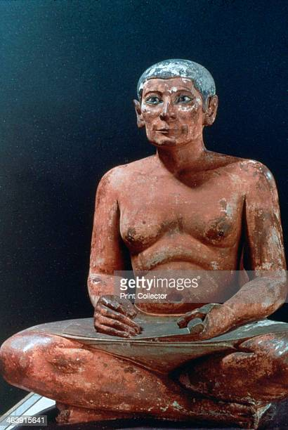 Ancient Egyptian figure of a seated scribe 25th24th century BC The figure is of painted limestone with inlaid eyes of rock crystal It dates from the...