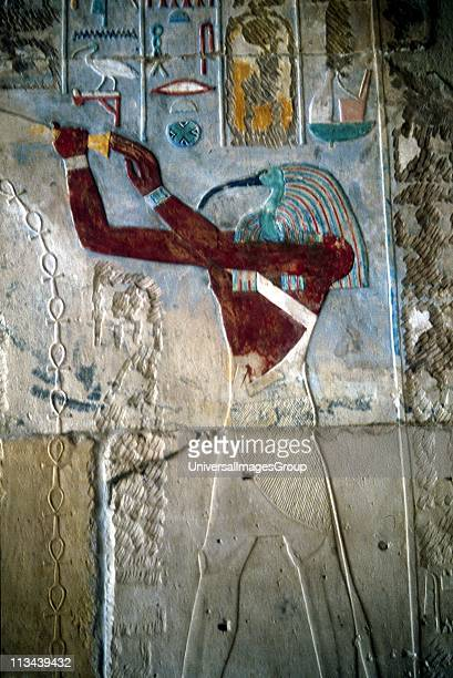 Ancient Egyptian Ibisheaded god Thoth secretary to the gods and patron of scribes wall painting from temple of Rameses II at Medinet Habu