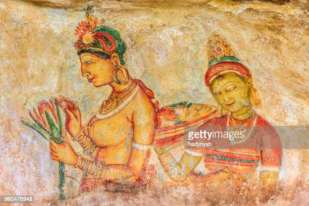 ancient fresco in the cave temple, sigiriya, sri lanka - sigiriya stock photos and pictures