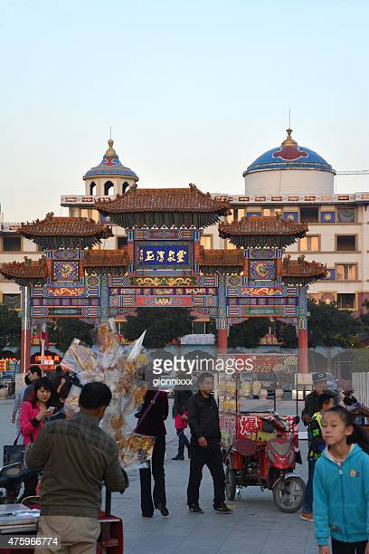 ancient gate and central square in hohhot, china - hohhot stock pictures, royalty-free photos & images