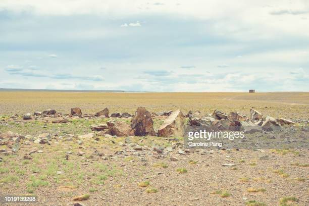 Ancient grave with stones in a circle found on Gobi desert in Mongolia.