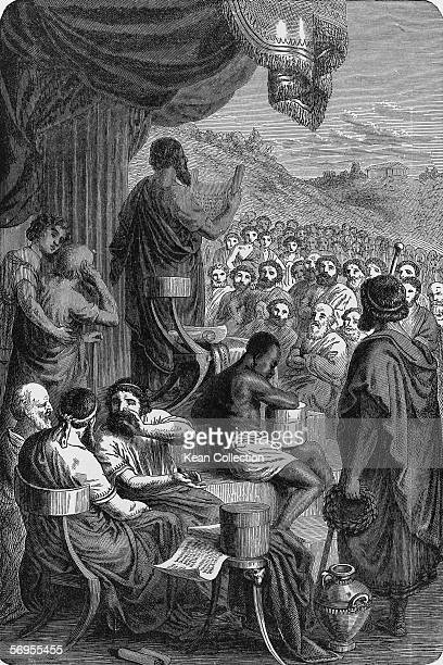 Ancient Greek historian Herodotus reads his 'Histories' to a large crowd of assembled Greeks in a late 19th Century engraving by Heinrich Leutemann