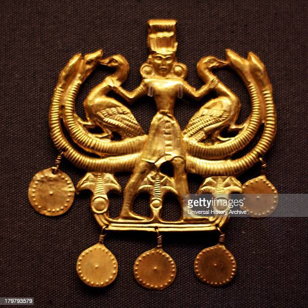 Ancient Greek 'Palace Age' Minoan Gold pendant Circa 18501550 BC From the Aegina treasures held at the British Museum London Originally from Aegina...