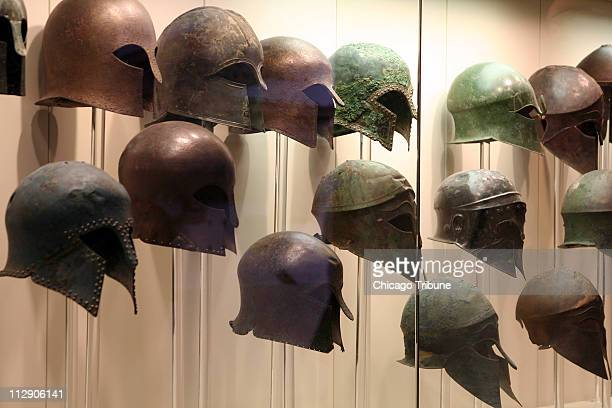Ancient Greeks fought their many wars wearing bronze helmets like these on view at the museum at Olympia Greece