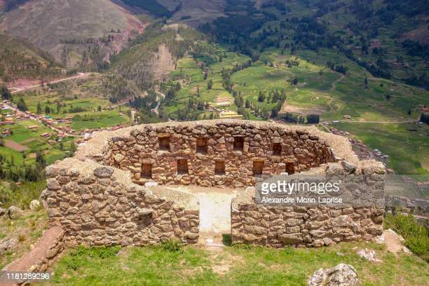 ancient incan fort in the ruins of pisac city in sacred valley, cuzco, peru - archaeology stock pictures, royalty-free photos & images