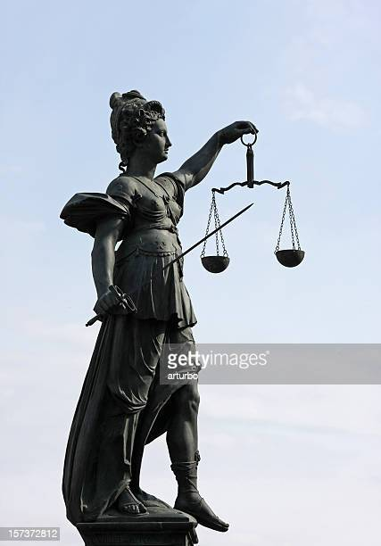 ancient Lady Justice statue full profile