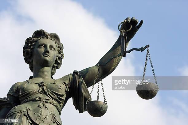 ancient Lady Justice statue half portrait