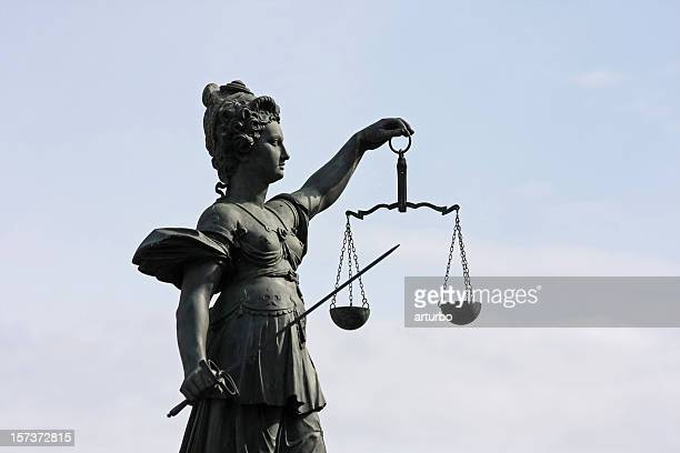 ancient Lady Justice statue half profile