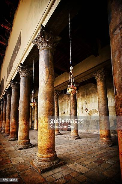 ancient lanterns hanging between columns - bethlehem west bank stock pictures, royalty-free photos & images