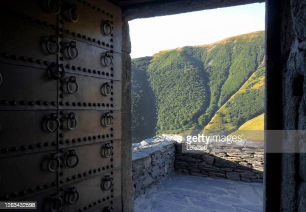 ancient monastery in the caucasus mountains during sunrise - georgian culture stock pictures, royalty-free photos & images