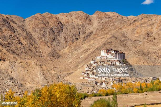 Ancient monastery or Gompa in autumn season with blue sky surrounded with stones and rocks , Leh, Ladakh, Jammu and Kashmir, India