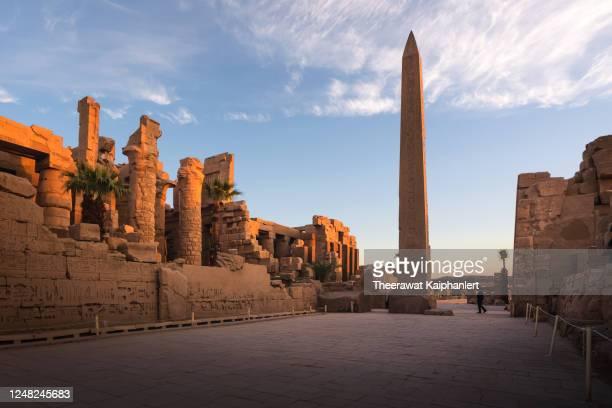 ancient obelisk pillar inside the karnak temple in luxor egypt during sunrise - temples of karnak stock pictures, royalty-free photos & images