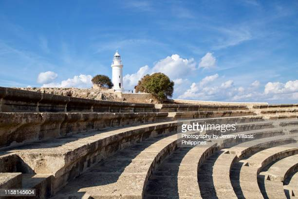 ancient odeon and lighthouse, paphos archaeological park - パフォス考古学公園 ストックフォトと画像
