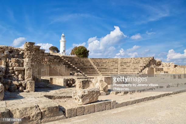 ancient odeon and lighthouse, paphos archaeological park - amphitheater stock photos and pictures