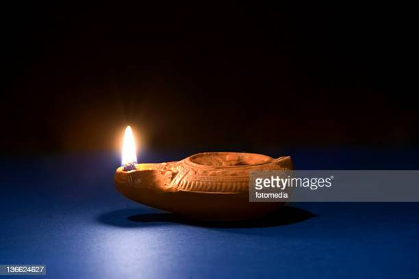 ancient oil lamp - clay stock pictures, royalty-free photos & images