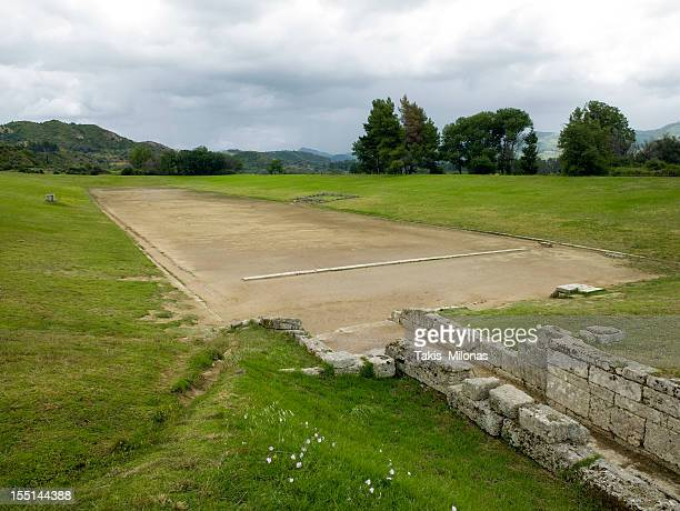 ancient olympias' stadium. - olympic stadium stock pictures, royalty-free photos & images
