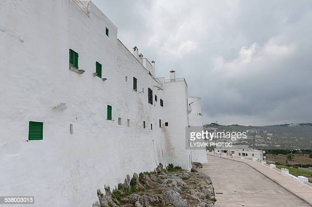 ancient outer walls of the white town ostuni - ostuni stock photos and pictures