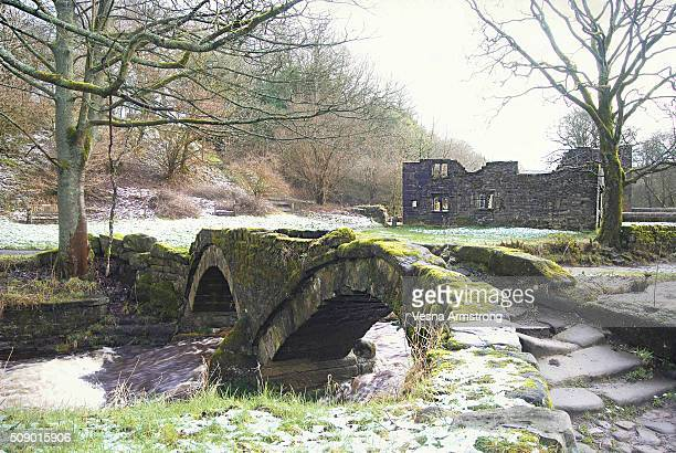 ancient pack horse bridge and wycoller hall - charlotte brontë stock photos and pictures