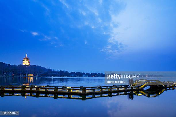 ancient pedestian bridge on water at twilight