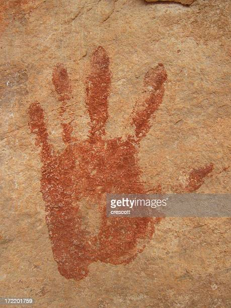 Ancient print of a left hand on a rocky wall