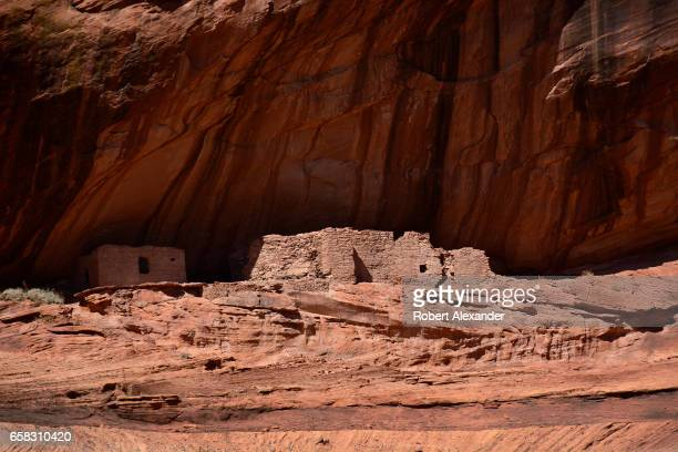 Ancient rock and mud dwellings built in the stone cliffs survive at Canyon de Chelly National Monument near Chinle, Arizona. The canyon has been...