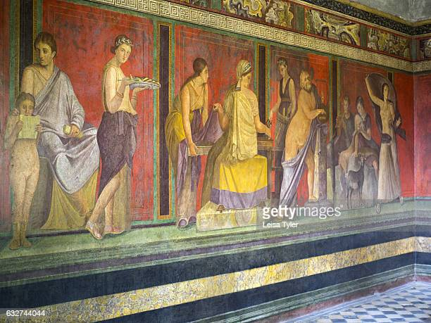 Ancient Roman frescoes in the Villa of Mysteries at Pompeii a once sophisticated Roman city that was buried in meters of ash and pumice after the...