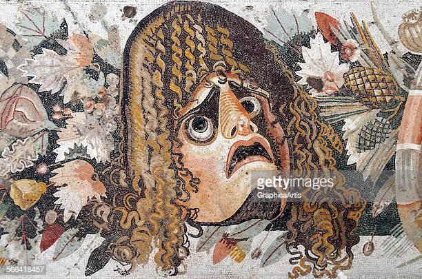 Ancient Roman mosaic of a tragic dramatic mask, from the House of the Faun in Pompeii; first century BC. From the Naples National Archaeological...