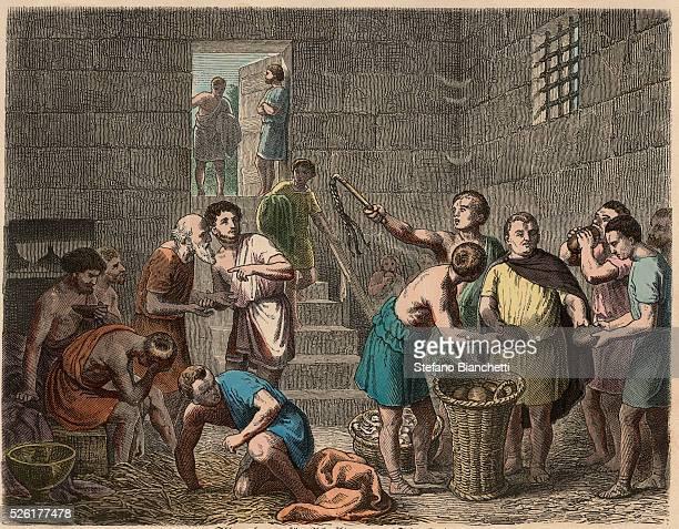 distribution of food to slaves in the evening Coloured engraving by Heinrich Leutemann Bilder aus dem Altertume 1866