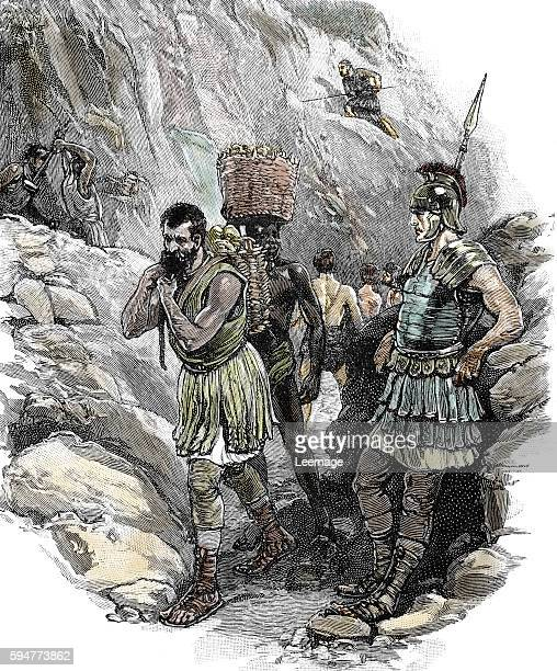 roman legionary supervising AngloSaxon workers in a tin mine in circa 50 AD England Private collection