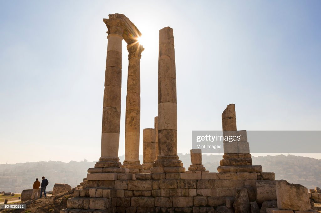 Ancient ruin of temple with architrave fragments and columns. : Stock Photo